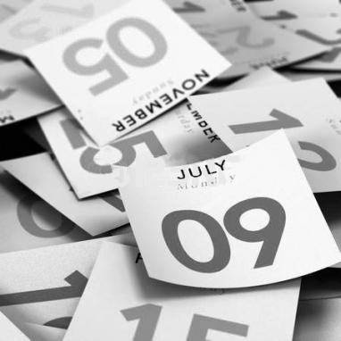 Calendar pages strewn BandW